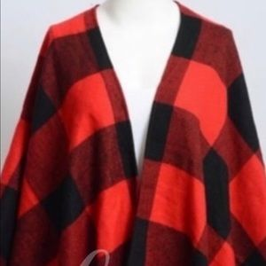1 red and black and 2 black and white ponchos.